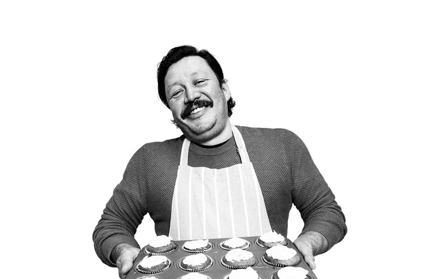 man holding tray of cupcakes